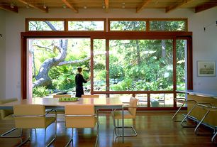 Contemporary Dining Room with Bellawood brazilian cherry, picture window, Exposed beam, can lights, Hardwood floors