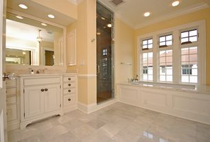 Traditional Master Bathroom with Shower, Crown molding, stone tile floors, Casement, Bathtub, Standard height, specialty door