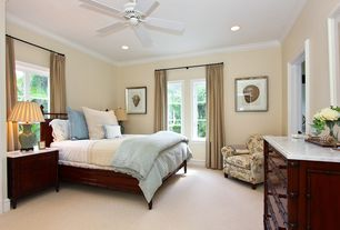 Traditional Guest Bedroom with Casement, Standard height, can lights, Carpet, Crown molding, Ceiling fan