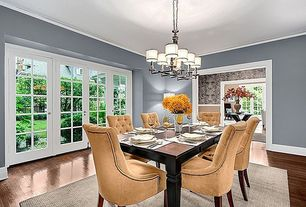 Traditional Dining Room with Paint, Hardwood floors, French doors, Hardwood flooring, Chandelier, Crown molding