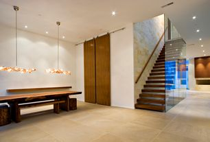 Contemporary Staircase with specialty door, Concrete tile , Floating staircase
