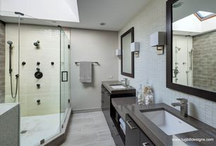 Modern Master Bathroom with frameless showerdoor, Large Ceramic Tile, Shower jets, Travertine counters, Undermount sink
