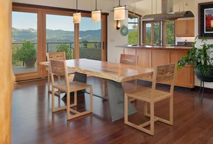 Contemporary Dining Room with French doors, Wall sconce, Pendant light, High ceiling, Balcony, Hardwood floors