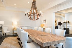 Traditional Dining Room with Standard height, Chandelier, Crown molding, can lights, Hardwood floors, Exposed beam