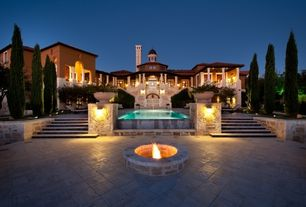 Mediterranean Exterior of Home with Fire pit, Natural stone exterior floor tiles, Arched window, exterior stone floors