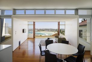 Contemporary Dining Room with specialty window, Hardwood floors, picture window, High ceiling