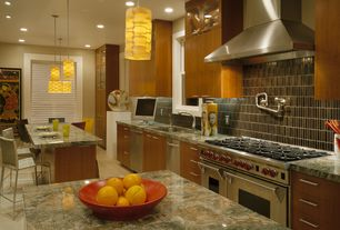 Contemporary Kitchen with double oven range, can lights, Onyx counters, limestone tile floors, Flush, Standard height