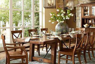 Rustic Dining Room with Pendant light, Hardwood floors, French doors, Built-in bookshelf