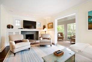 Contemporary Living Room with Built-in bookshelf, Crown molding, Cement fireplace, Hardwood floors