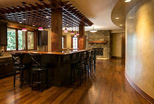 Country Bar with Columns, Hardwood floors, can lights, Standard height, Pendant light, Built-in bookshelf, Casement