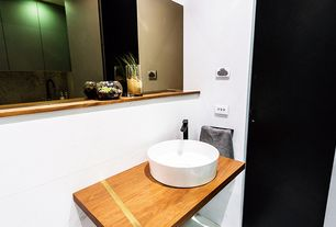 Contemporary Powder Room with flat door, Kohler vox round above counter bathroom sink, Vessel sink, Standard height