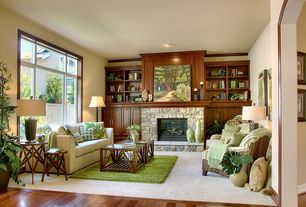 Craftsman Living Room with Fireplace, Built-in bookshelf, Threshold stamped metal accent table - gold, Paint, Crown molding