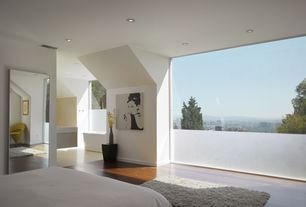 Contemporary Master Bedroom with Laminate floors, Verner Panton Cone chair for Plus Linje, Ormond Area Rug