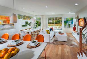 Contemporary Great Room with Standard height, Pendant light, can lights, Hardwood floors, sliding glass door, Skylight