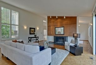 Contemporary Living Room with Wall sconce, Hardwood floors, stone fireplace, flush light