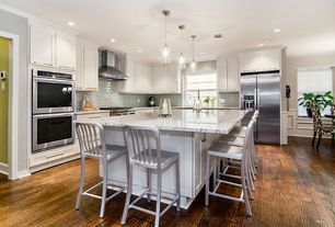 Contemporary Kitchen with L-shaped, Flat panel cabinets, Subway Tile, Pendant light, Complex marble counters, Breakfast bar
