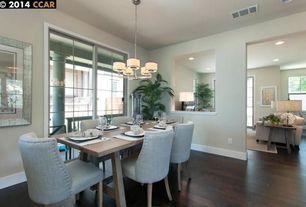 Contemporary Dining Room with Standard height, sliding glass door, Hardwood floors, Chandelier