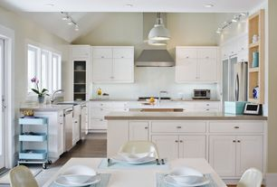 Contemporary Kitchen with French doors, Corian Granola Solid Surface Countertop, Glass panel, Pendant light, High ceiling