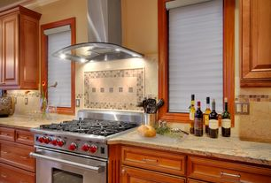 Traditional Kitchen with Crown molding, Stone Tile, Complex granite counters, Raised panel, Limestone Tile, One-wall