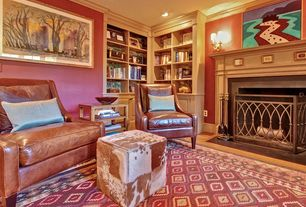 Eclectic Living Room with Built-in bookshelf, stone fireplace, Crown molding, Wall sconce, Standard height, can lights