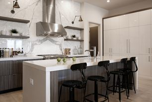 Contemporary Kitchen with Flush, Waterfall countertop, Limestone counters, Wall sconce, Kitchen island with seating, L-shaped