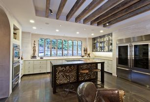 Contemporary Kitchen with Undermount sink, Concrete tile , Kitchen island, Flush, U-shaped, electric cooktop, can lights