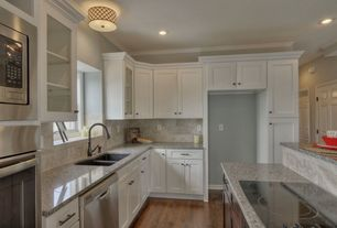 Traditional Kitchen with Simple granite counters, Stone Tile, Flat panel cabinets, Complex Granite Tile, Flush, Azul platino
