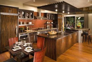 Contemporary Kitchen with can lights, European Cabinets, Flush, Simple granite counters, double oven range, Undermount sink