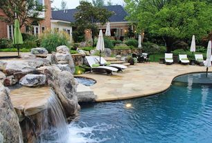 Traditional Patio with exterior stone floors, Transom window, Raised beds, French doors, Pathway, exterior awning, Fence