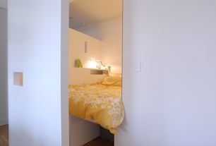 Contemporary Master Bedroom with Hardwood floors, Built-in bookshelf, Paint 1, Standard height