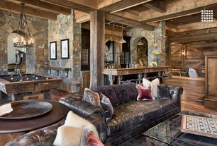 Rustic Game Room with Pool table, Interior stone wall, Hickory - light chestnut 4.8 in. engineered hardwood plank, Chandelier