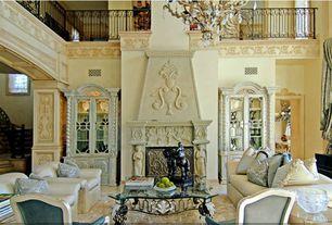 Traditional Living Room with Chandelier, Cathedral ceiling, Casement, Built-in bookshelf, Concrete floors, Sunken living room