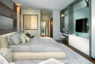 Contemporary Master Bedroom with Platform bed, Neutral area rug, Glass wall panel, Pendant light, Acoustic wall panel