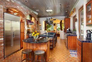 Eclectic Kitchen with European Cabinets, French doors, Crown molding, Breakfast bar, Stainless Steel, Flush, Skylight