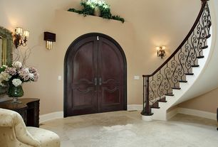 Mediterranean Entryway with French doors, travertine tile floors, High ceiling, Wall sconce