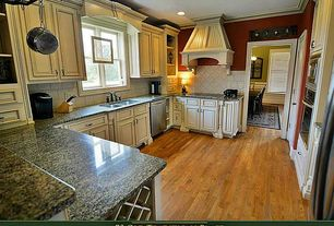 Country Kitchen with Stone Tile, specialty door, Complex granite counters, Oak - spice brown 2 1/4 in. solid hardwood strip