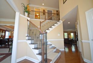 Staircase with can lights, Loft, Crown molding, Chair rail, Cathedral ceiling, curved staircase, Hardwood floors