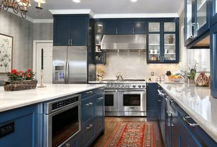 Traditional Kitchen with dishwasher, Glass panel, Crown molding, Undermount sink, Wall Hood, L-shaped, Kitchen island, Flush