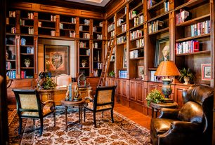 Traditional Home Office with Hardwood floors, Built-in bookshelf, Crown molding, High ceiling
