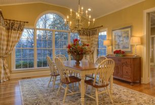 Eclectic Dining Room with Chandelier, Crown molding, Arched window, Hardwood floors