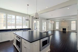 Traditional Great Room with Oversized cone paper shade pendant, Stainless steel appliances
