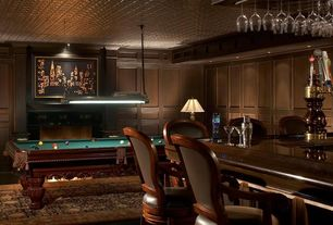Traditional Game Room with Crown molding, Laminate floors, American heritage barstool with cushion, Wood paneling walls