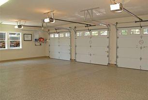 Traditional Garage with simple granite floors, specialty door, flush light