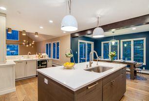 Contemporary Kitchen with European Cabinets, Limestone Tile, Pendant light, Corian counters, flush light, Wine refrigerator