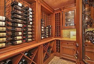 Craftsman Wine Cellar with Crown molding, Built-in bookshelf, limestone floors, specialty door