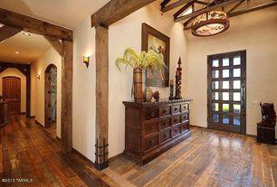 Rustic Entryway with Hardwood floors, Standard height, Glass panel door, Built-in bookshelf, Pendant light, Exposed beam
