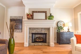 Cottage Living Room with stone fireplace, Hardwood floors, Crown molding