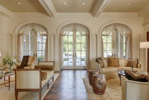 Traditional Living Room with Hardwood floors, can lights, Crown molding, French doors, Standard height