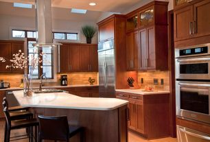 Contemporary Kitchen with Hardwood floors, Quartz counters, double wall oven, Undermount sink, Island Hood, can lights