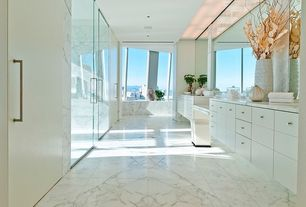 Modern Master Bathroom with Complex marble counters, stone tile floors, Shower, can lights, Flush, European Cabinets